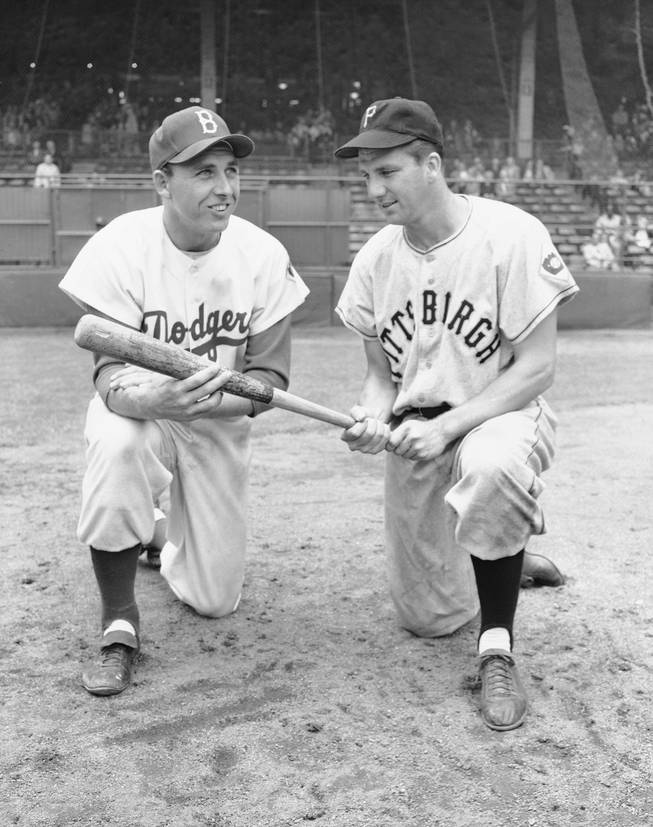 In this July 23, 1951 file photo, Gil Hodges, left, and Ralph Kiner pose. The baseball Hall of Fame says slugger Ralph Kiner has died. He was 91. The Hall says Kiner died Thursday, Feb. 6, 2014, at his home in Rancho Mirage, Calif.