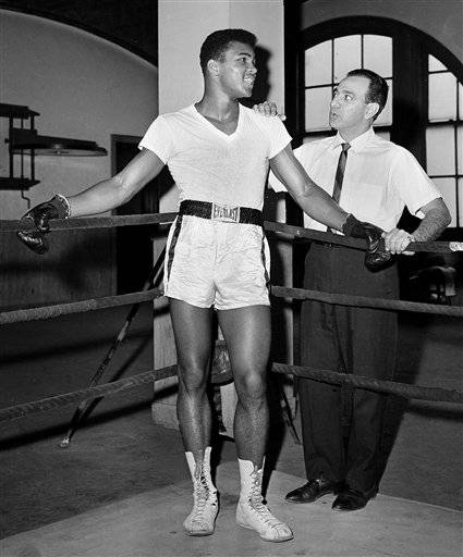 In this Feb. 8, 1962, file photo, young heavyweight fighter Cassius Clay, who later changed his name to Muhammad Ali, is seen with his trainer Angelo Dundee at City Parks Gym in New York. Ali turned 70 on Jan. 17, 2012.