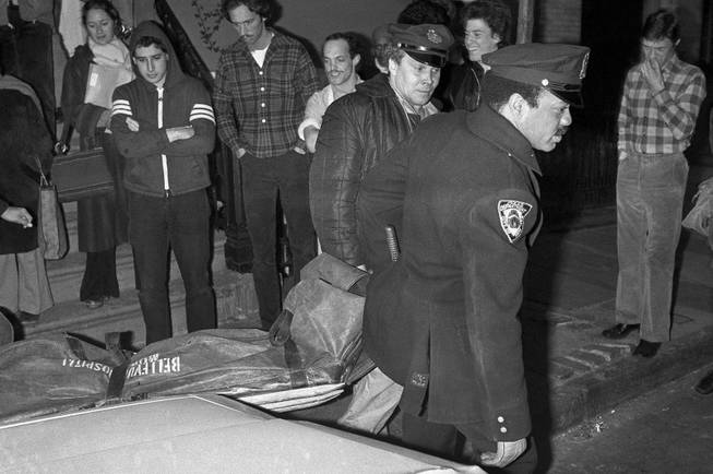 In this Feb. 2, 1979 file photo, New York City police carry the body of punk rock singer Sid Vicious from an apartment in the Greenwich Village area of New York. Authorities said that Sid Vicious, whose real name was John Simon Ritchie, apparently died of an overdose of heroin he took at a party celebrating his release from prison the day before. He had been released on $50,000 bail pending trial in the fatal stabbing of his girlfriend Nancy Spungen.