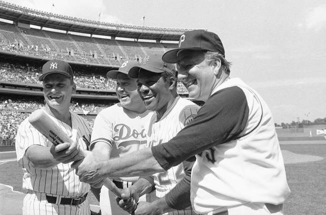 In this Aug. 23, 1980, file photo, Hall of Famers from left, Roger Maris, Duke Snider, Willie Mays and Ralph Kiner, pose for pictures before the annual New York Mets Old Timers Day at Shea Stadium in New York. The baseball Hall of Fame says slugger Ralph Kiner has died. He was 91. The Hall says Kiner died Thursday, Feb. 6, 2014, at his home in Rancho Mirage, Calif.