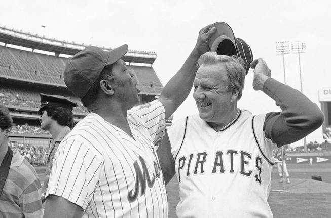 Willie Mays tries to get Ralph Kiners hat as the two Hall of Famers pose for pictures before the start of Old Timers Day game at Shea Stadium in New York on Saturday, August 14, 1982.  Kiner never wore the turn of the century cap that the present day Pirates wear during his playing days.