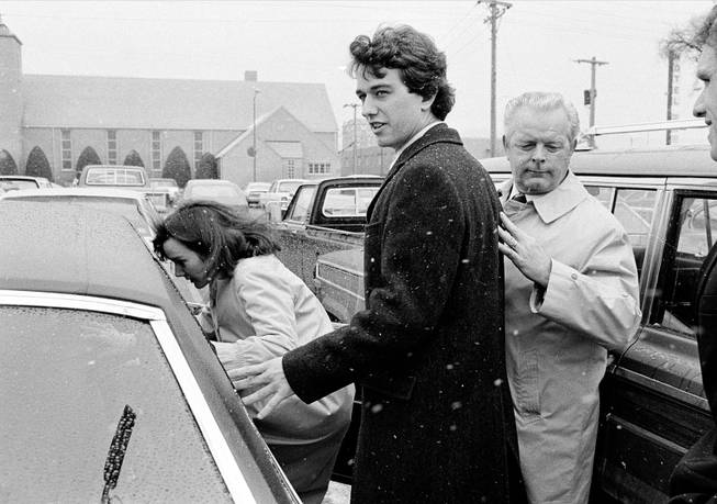In this March 17, 1984 file photo, Robert Kennedy Jr. and his wife, Emily, get into a car as they are escorted by private investigator Don Wiley outside the courthouse in Rapid City, S.D. Kennedy received a suspended sentence and two years probation on his guilty plea to a charge of heroin possession.