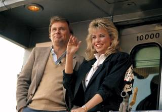 Pat Sajak and Vanna White prepare to leave Miami aboard