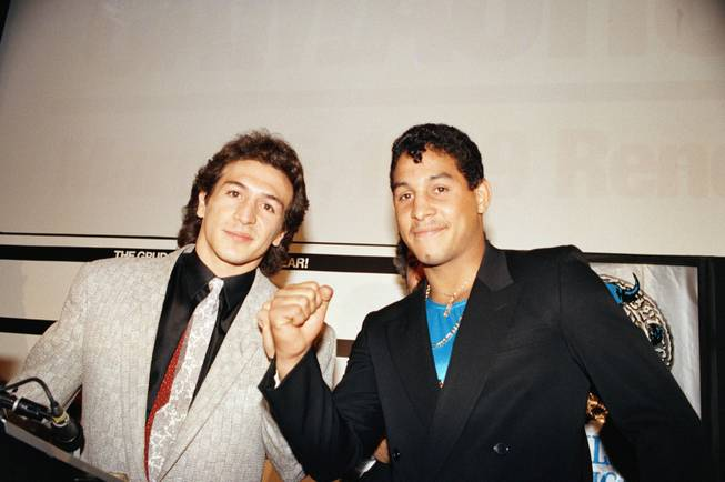 "Ray ""Boom Boom"" Mancini, left and Hector ""Macho"" Camacho take the typical pose after holding a news conference in New York City, Dec. 19, 1988. They announced their ""grudge fight"" in Reno, Nevada for March 6."