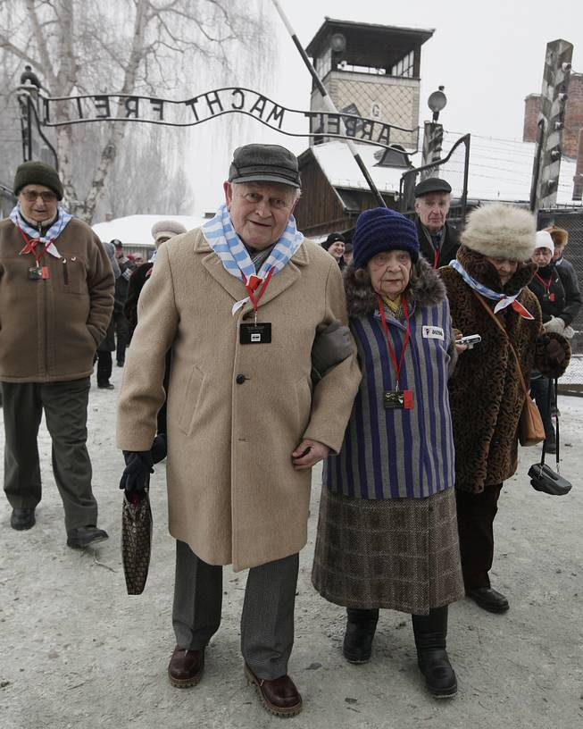 Holocaust survivors arrive for a ceremony to mark the 69th anniversary of the liberation of Auschwitz Nazi death camp's  in Oswiecim, Poland, on Monday, Jan. 27, 2014, since the Soviet Red Army liberated the camp. Israeli lawmakers and government officials are to attend anniversary observances later in the day.