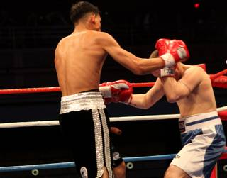 Jose Benavidez Jr. throws a punch at Steven Cox in their super lightweight fight Saturday at the Joint inside the Hard Rock. Benavidez Jr. won by TKO in the first round.