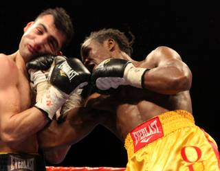 Kassim Ouma throws a punch at Vanes Martiosyan during their NABO/NABF super welterweight title fight Saturday at the Joint inside the Hard Rock. Martiosyan won the fight by unanimous decision.