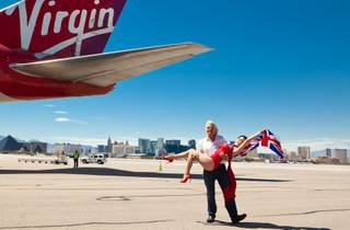 Sir Richard Branson and Dita Von Teese arrive at McCarran Airport on June 15, 2010.