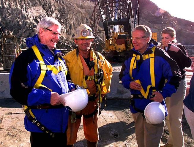 "From left, Governor Kenny Guinn, miner Jay Stone and Senator Harry Reid get ready to descend into the new water intake tunnel at Lake Mead with the help of Southern Nevada Water Authority public information officer Kristen Howey during the ""Last Man Out"" event Saturday, January 22, 2000."