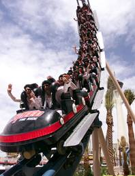 Twenty-four members of the parachute team The Flying Elvi take the ceremonial first trip on the new rollercoaster Speed - The Ride at the Sahara on April 28, 2000.