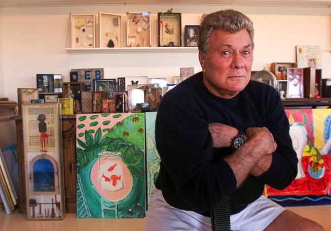 Tony Curtis poses for a photo in the art studio of his home Friday, November 30, 2001. Curtis will have a retrospective exhibit of his work at UNLV beginning December 10th.