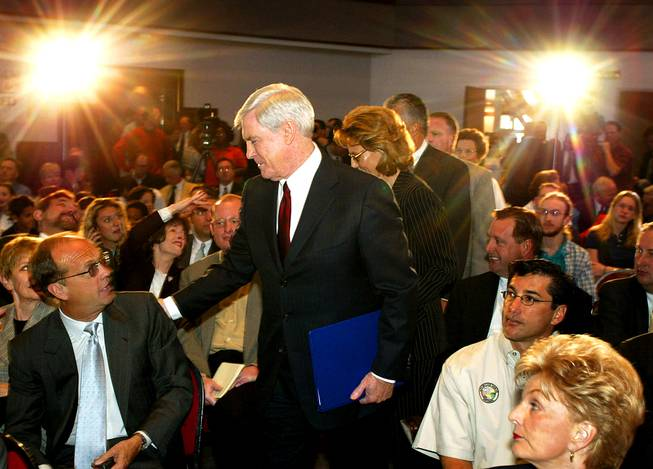 Mandalay Bay Resort Group executive Mike Sloan, left, is greeted by Nevada Gov. Kenny Guinn as he makes his way to the podium before his Yucca Mountain veto speech Monday, April 8, 2002 at UNLV.