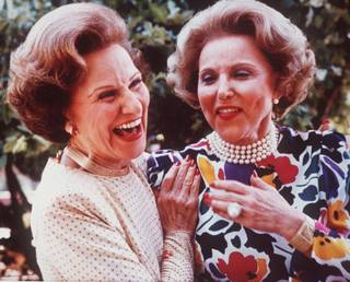 Advice columnist Ann Landers, right, and her twin sister Pauline, who also wrote an advice column as Dear Abby, are shown in a photo from June 1986, at their 50th high school reunion in Sioux City, Iowa.