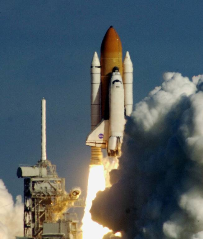 The space shuttle Columbia clears the pad on way to orbit after liftoff at the Kennedy Space Center in Cape Canaveral, Fla. in this Thursday Jan. 16, 2003 photo. Shortly after Columbia lifted off, a piece of insulating foam on its external fuel tank came off and was believed to have hit the left wing of the shuttle. Leroy Cain, the lead flight director in Mission Control, assured reporters Friday, Jan. 31, 2003, that engineers had concluded that any damage to the wing was considered minor and posed no safety hazard.