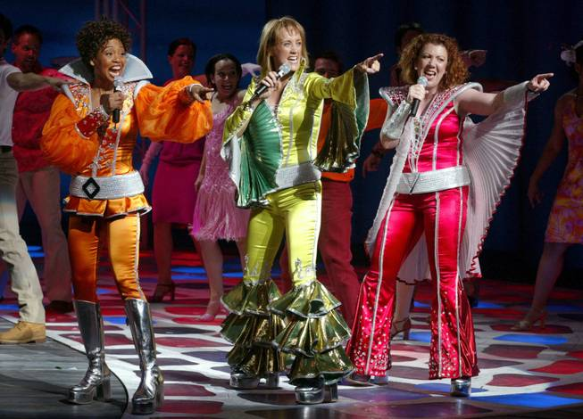 Tanya, left, (played by Karole Foreman), Donna Sheridan, center, (Tina Walsh) and Rosie (Jennifer Perry) perform during a dress rehearsal of the musical Mama Mia at the Mandalay Bay Sunday February 2, 2003.