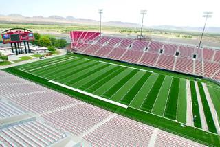 Employees with Sun State Landscaping of Las Vegas continue to install a Turf Technologies Sports Turf at Sam Boyd Stadium Thursday, Aug. 14, 2003. Installation of the turf is nearly 90-percent complete.