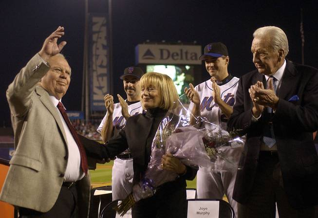New York Mets announcer Bob Murphy, left. acknowledges fans as his wife Joye, fellow broadcaster Ralph Kiner, right, pitchers John Franco and Al Leiter applaude at a ceremony to celebrate his career as the with the Mets before a game against the  Pittsburgh Pirates at Shea Stadium in New York, Thursday, Sept. 25, 2003. Murphy, the Mets announcer since 1962, will retire after tonights game.
