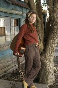 "Musician Ani DiFranco stands outside her home in New Orleans Dec. 30, 2003. DiFranco, 33, produced her latest album, ""Educated Guess,"" on her own as well as playing all the instruments herself. (AP Photo/Bill Haber)"