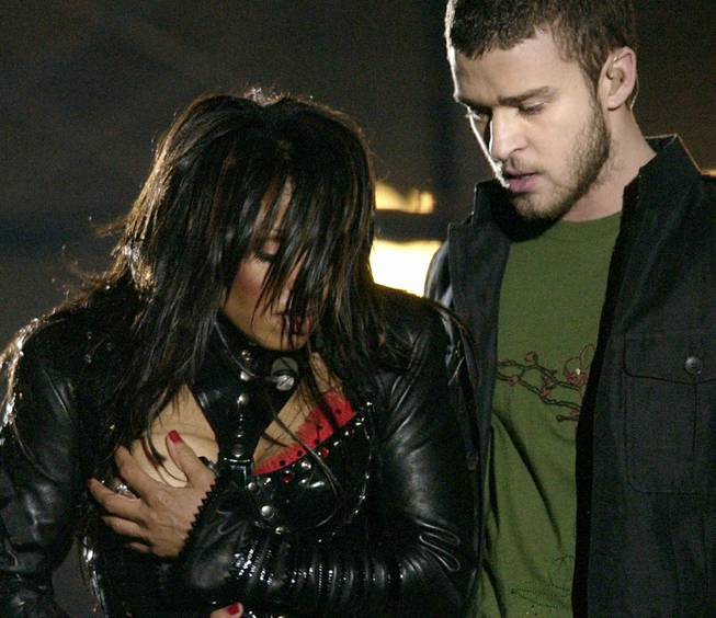 Entertainer Janet Jackson covers her breast after her outfit came undone during her half time performance with Justine Timberlake at the Super Bowl XXXVIII game  in Houston, Sunday Feb. 1, 2004.