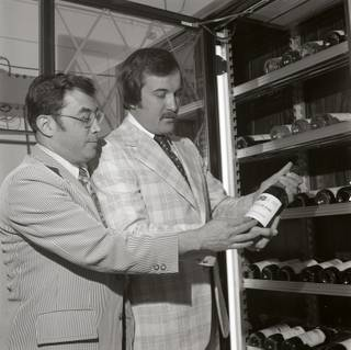 In this undated photo Jerry Vallen, left, and Larry Ruvo look over a bottle of wine circa late 1970's.