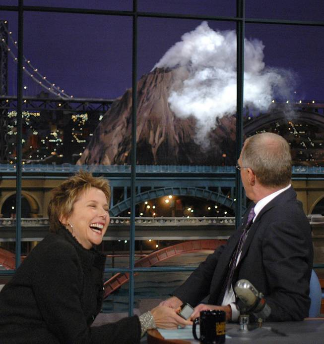 "Actress Annette Benning, left, fires up the ""Hudson River Volcano"" as host David Letterman watches during a taping of ""Late Show with David Letterman""  Tuesday, Oct. 5, 2004, in New York."