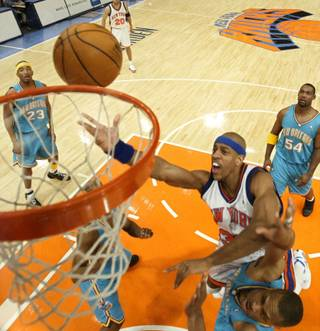New York Knicks' Jerome Williams puts up a shot against New Orleans Hornets' P. J. Brown during the first quarter Tuesday, Jan. 11, 2005 at Madison Square Garden in New York. The Hornets won 88-82.