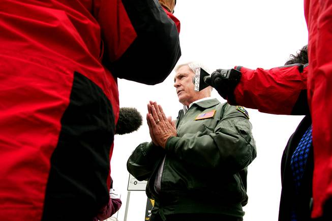 Governor Kenny Guinn briefs the media after flying over the flooded areas of Overton Thursday, January 13, 2005.