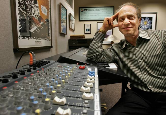 Author and inventor Ray Kurzweil, 56, sits in front of a music mixing board in his office, in Wellesley, Mass., Jan. 12, 2005.