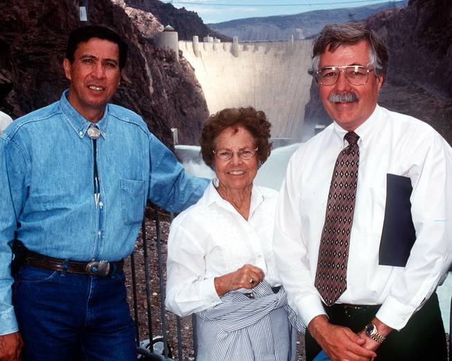 Pictured is Eluid Martinez, Commissioner of the Bureau of Reclamation; Gene Segerblom, Nevada State Assembly Woman; and Bob Johnson, Lower Colorado Regional Director for the Bureau of Reclamation taken on June 11,1998. Tests were being conducted on new needle valves replaced recently in the outlet works at Hoover Dam. View from downriver.