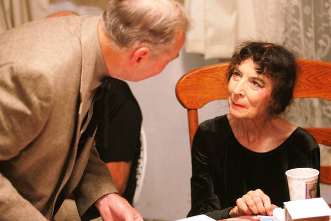"Marta Becket talks to friends after performing her one-woman show ""Masquerade"" to open the 2005-2006 season at the Amargosa Opera House in Death Valley Junction Oct. 1st, 2005."