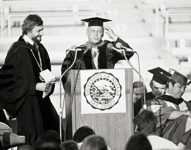 Frank Sinatra receives an honorary doctorate from UNLV President Donald Baepler during the 1976 commencement. (UNLV Special Collections)