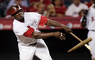 Los Angeles Angels'  Vladimir Guerrero breaks his bat against the Baltimore Orioles during the third inning of their baseball game Tuesday, Sept. 5, 2006, in Anaheim, Calif.