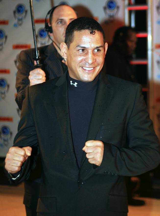 "FILE - In this Dec. 14, 2006, file photo, boxer Hector ""Macho"" Camacho of Puerto Rico arrives for the Premios Fox Sports at the Jackie Gleason Theater in Miami Beach, Fla. Camacho's life and career have taken more turns than a pulp novel, from the gritty streets of Spanish Harlem to the bright lights of the Golden Gloves, from walking between the bars of a jail cell to stepping between the ropes of the ring."