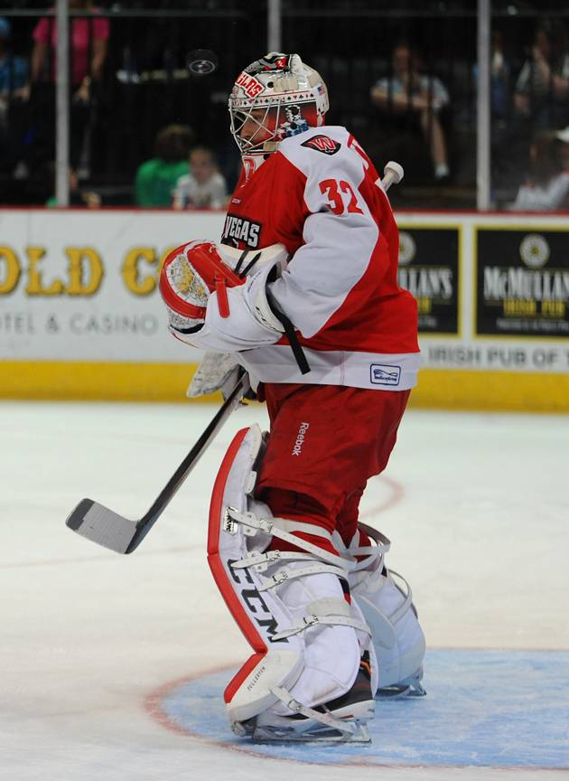 Las Vegas Wranglers goaltender Travis Fullerton stands to stop an Alaska Aces shot during the first period of play on Saturday night at the Orleans Arena.