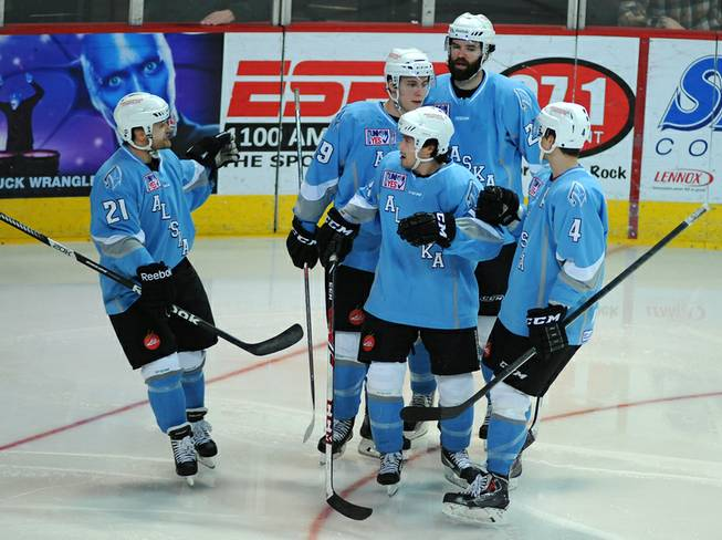 Alaska Aces players come together to congratulate forward Evan Trupp (center) after he scored a second period goal against the Las Vegas Wranglers on Saturday night.