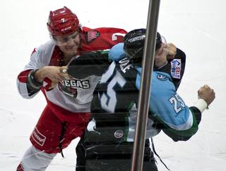 Las Vegas Wranglers forward Alexandre Mentink (7) fights Alaska Aces defenseman Dustin Molle (25) in the opening seconds of the first period on Sunday afternoon at the Orleans Arena.