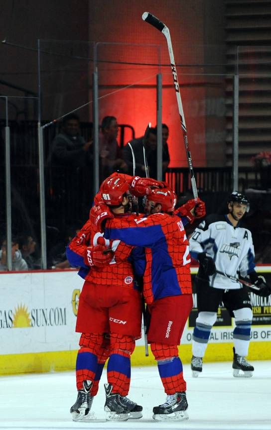 Wranglers players celebrate after center John Armstrong scored an empty-net goal against the Idaho Steelheads in the final seconds of the third period on Saturday night.