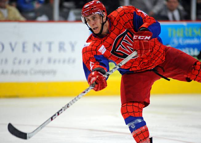 Las Vegas Wranglers center Chris Francis takes a shot against the Idaho Steelheads during the third period of play on Saturday, March 1, 2014, at Orleans Arena. The  Spiderman-style jerseys were to be auctioned off during the game with proceeds benefiting UMC Children's Hospital.