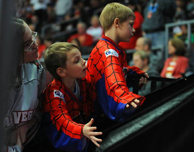 "Young Wrangler fans look to high-five players coming onto the ice for the third period of play between Las Vegas and the Idaho Steelheads on ""Spiderman Night"" at the Orleans Arena on Saturday night."