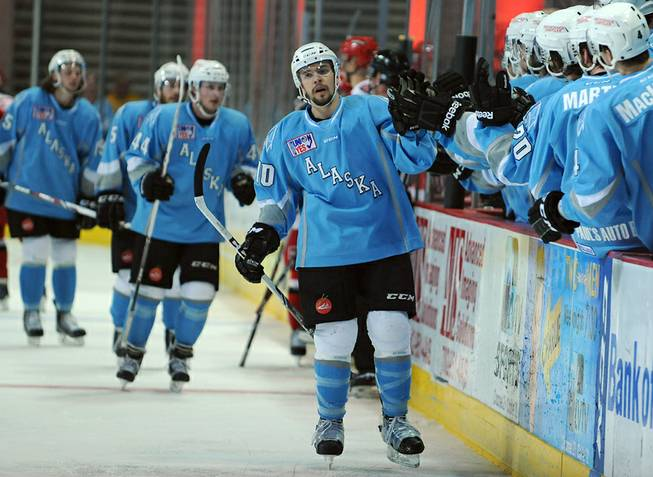 Alaska Aces winger Alex Belzile skates along his bench in celebration after his line scored a goal against the Las Vegas Wranglers on Sunday afternoon at the Orleans Arena.