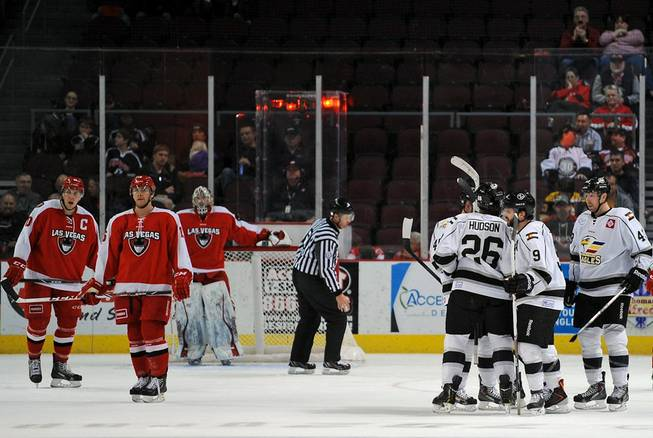 Colorado Eagles players celebrate after scoring a fifth goal against the Las Vegas Wranglers on Tuesday night at the Orleans Arena.