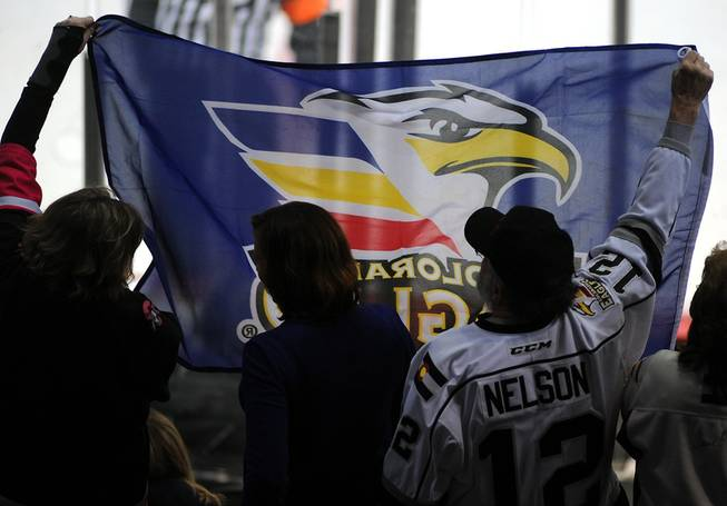 Colorado Eagles fans wave a flag as they celebrate a goal scored against the Las Vegas Wranglers on Tuesday night at the Orleans Arena.