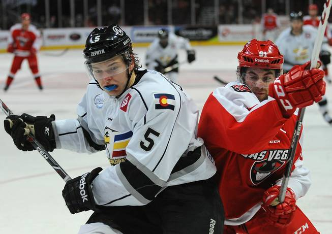 Colorado Eagles defenseman Daniel Johnston (5) battles for position with Las Vegas Wranglers center John Armstrong (91) during the second period on Tuesday night at the Orleans Arena.
