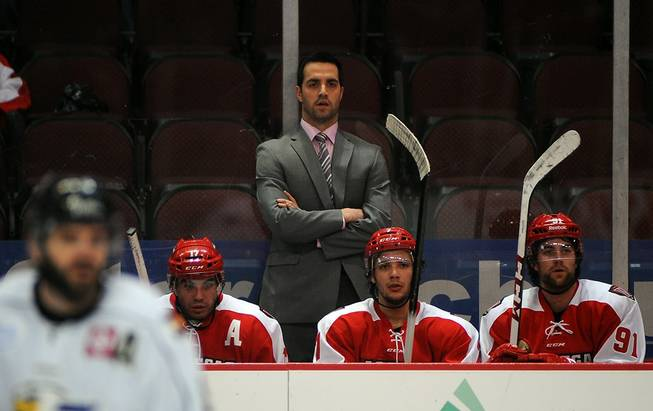 Las Vegas Wranglers head coach Mike Madill watches from behind the bench during a game against the Colorado Eagles on Tuesday night.