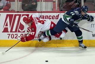 Las Vegas Wranglers right wing Cody Purves (47) gets tripped up by Florida Everblades defenseman Olivier Dame-Malka (44) during an ECHL game at the Orleans Arena on Tuesday night.