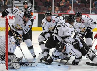 Colorado Eagles players swarm around the puck to help protect their net during the third period of a game at the Orleans Arena on Wednesday night.