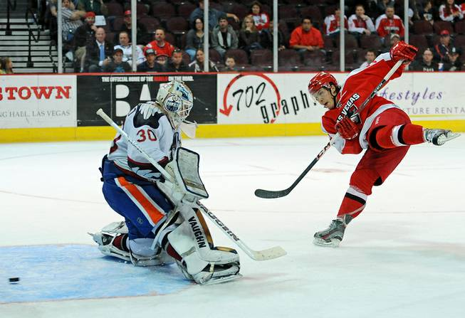 Las Vegas Wranglers forward Chad Nehring scores on a penalty shot against Bakersfield Condors goaltender Laurent Brossoit during the third period of play on Tuesday night.
