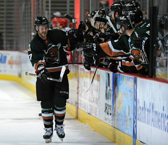 Utah Grizzlies forward Mathieu Aubin skates along his bench in celebration after scoring a shootout goal against the Las Vegas Wrangers after the two teams skated to a 3-3 draw in regulation time on Friday night. Utah won the game in a shootout, 4-3.