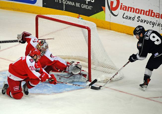Las Vegas Wranglers goaltender Mitch O'Keefe covers the post with a pad to stop a scoring attempt by Colorado Eagles forward Kevin Ulanski during the first period on Tuesday night.
