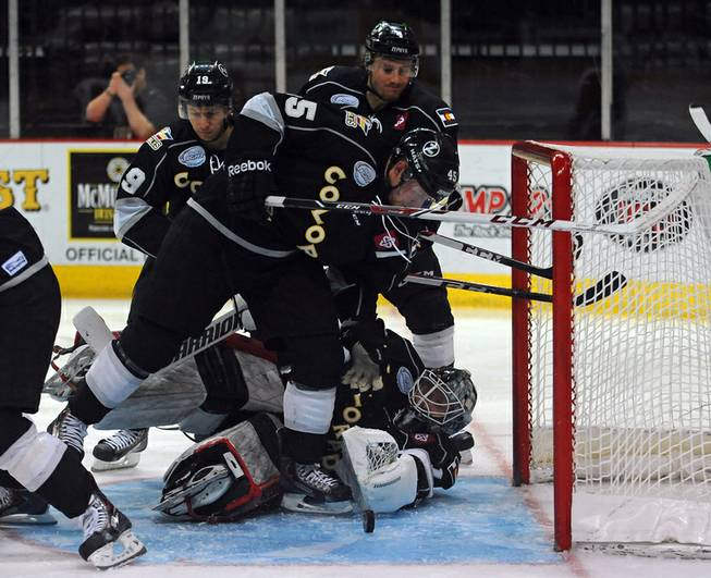 With Colorado goaltender Dustin Butler out of position, Eagles forward Trent Daavettila looks to shoot a loose puck out of the crease during a second period scoring attempt on Tuesday night.